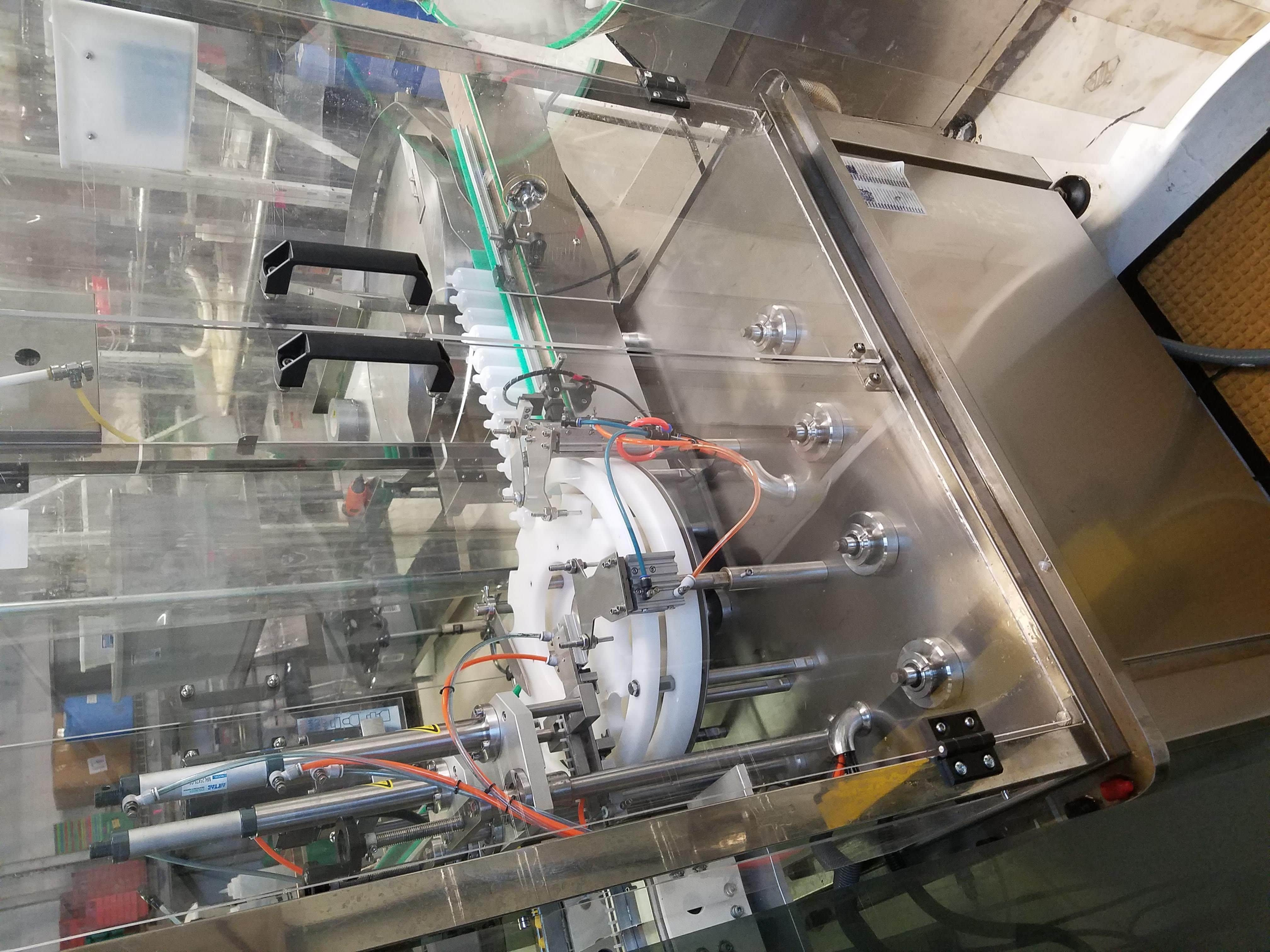 Complete plastic / glass boston round bottle automated fillng, droppering, and capping machine. Siemens Smart Line and Mistubishi PLC controlled. Comes with various spare parts.