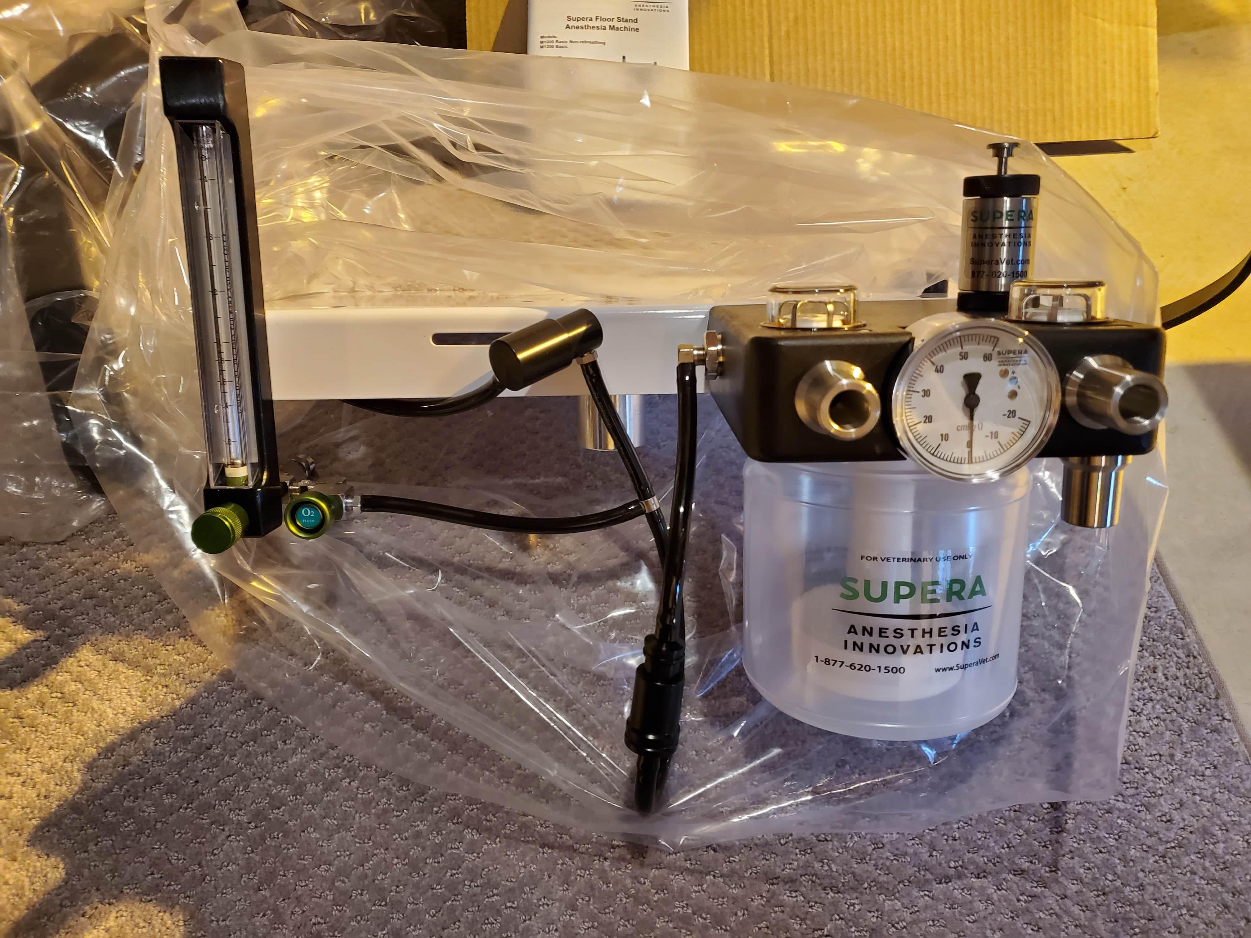 Supera M1200 veterinary anesthesia machine (never used) and EVC3000 gas evac system (zero hours)