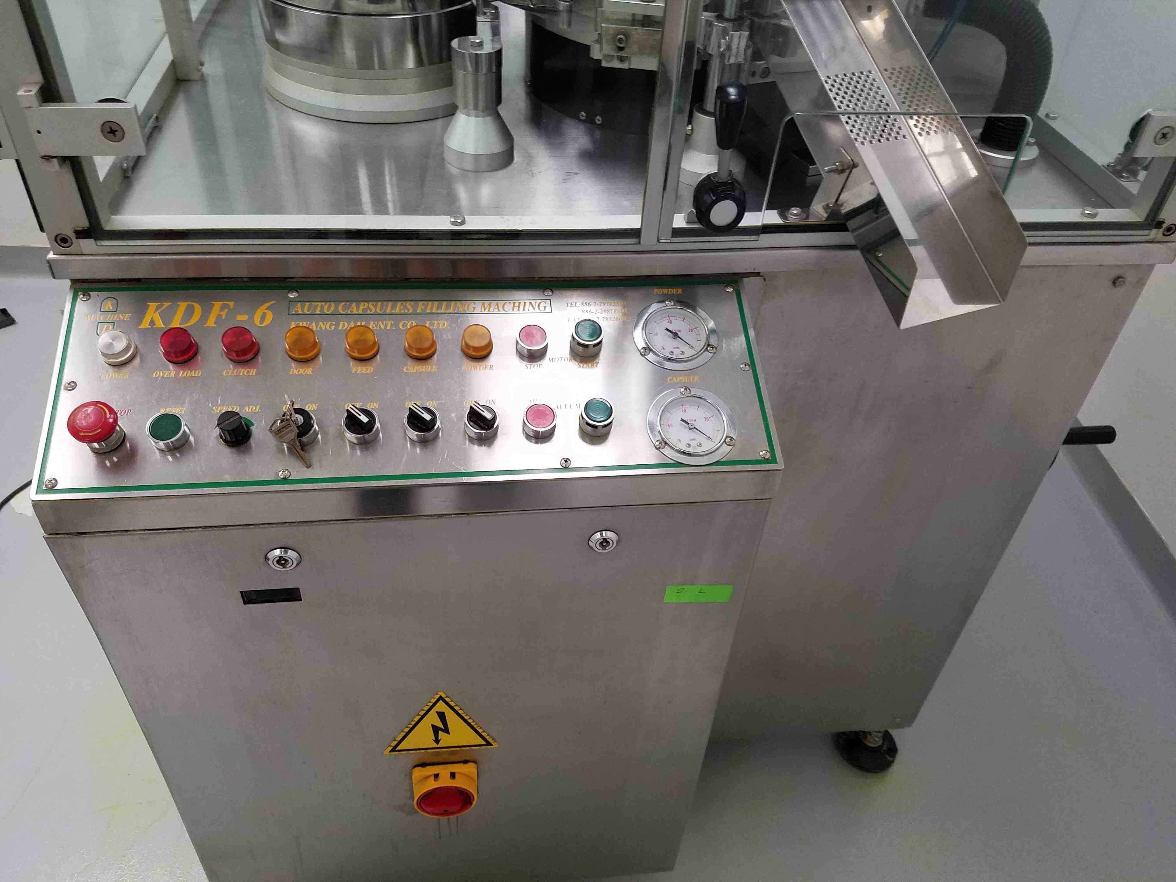 Fully automatic Kwang Dah encapsulator with 00, 0 and 1 change parts