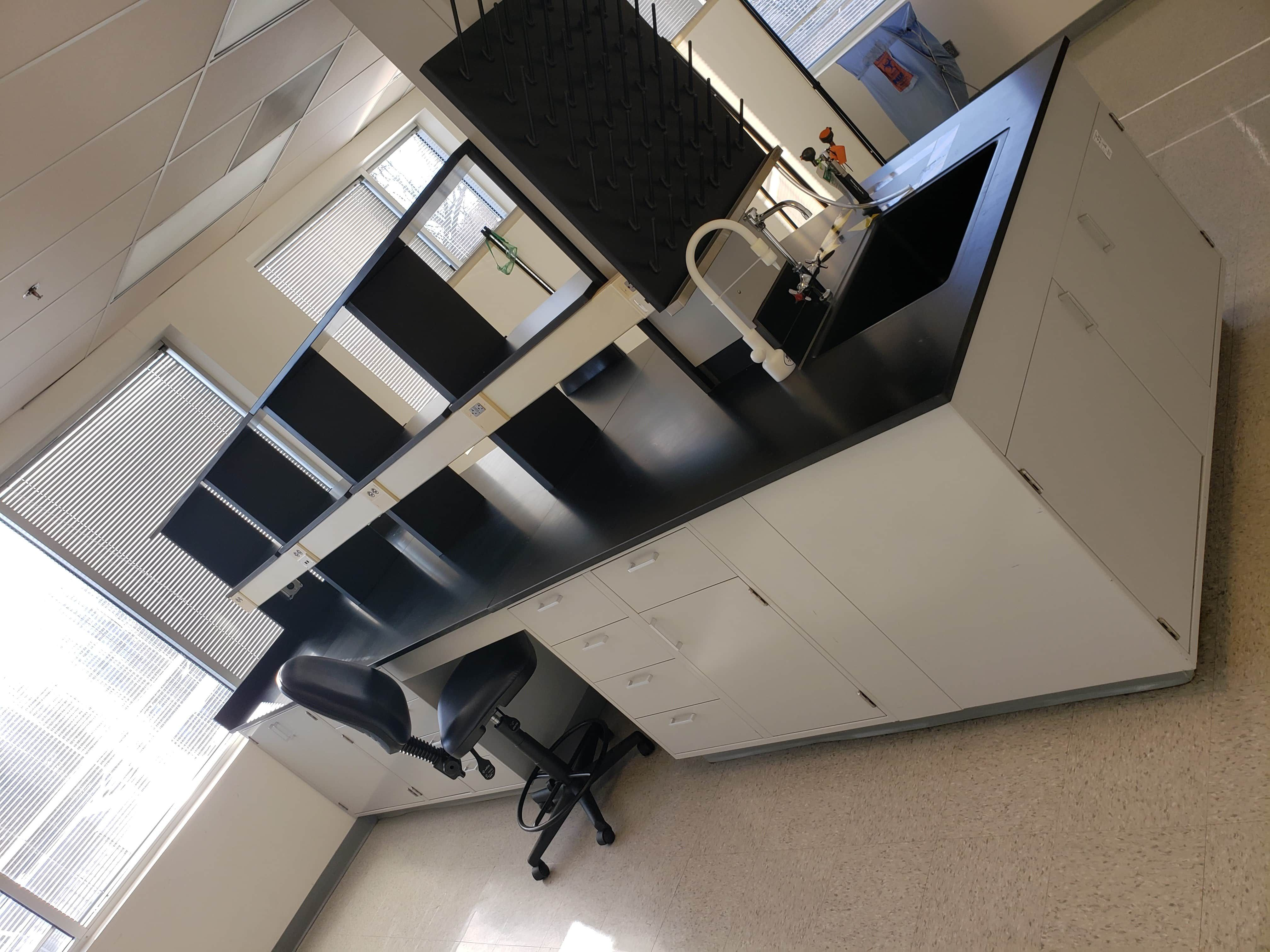 14.5 foot Metal casework island with sink and shelving (Pre-owned)